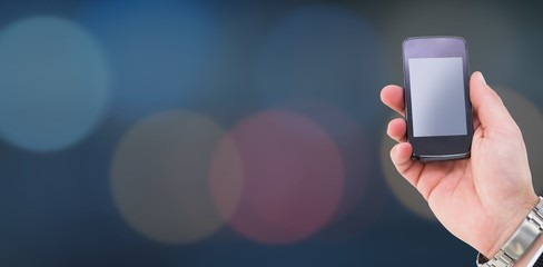 Composite image of hand of a businessman holding mobile phone 3d