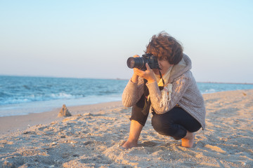 Female photographer on the beach
