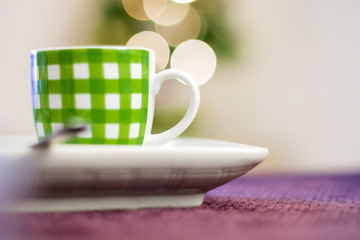 close up of a green striped coffee cup