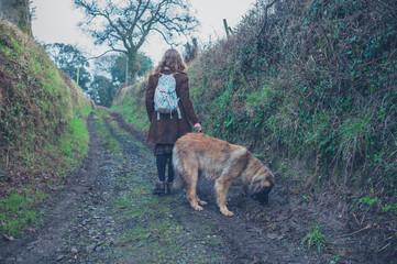 Woman walking dog in nature