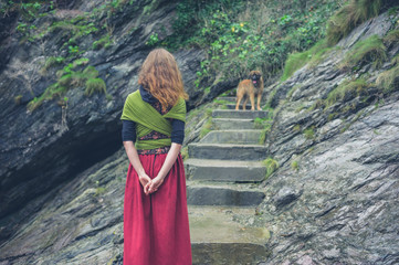 Woman walking dog in nature