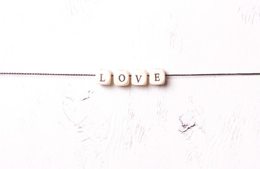 "The word ""Love"" from cubes on a white background"