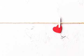 Red wooden heart on a white background