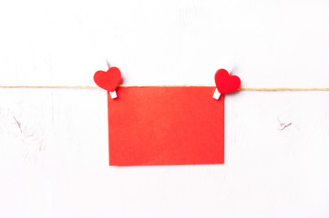two red wooden heart hold leaf