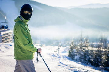 Young man is skiing in mountains
