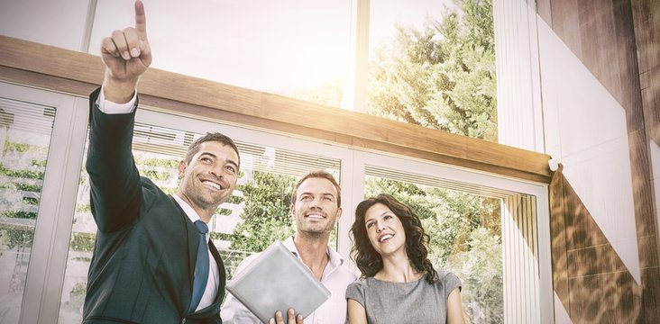 Real-estate agent showing couple new home