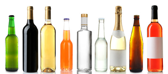 Bottles with different drinks on white background