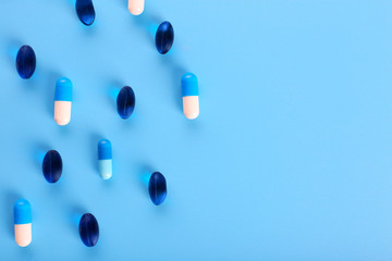Many pills on blue background