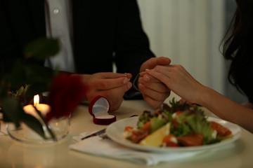 Wedding proposal in restaurant