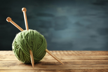 Ball of  knitting yarn on wooden table
