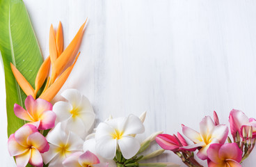 white wood texture with Heliconia and plumeria flower