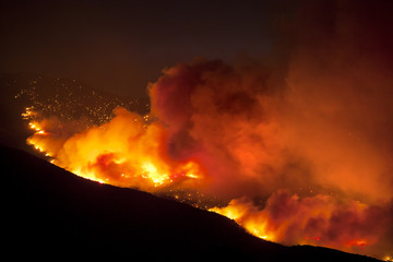 Wildfire burning on a hillside in rural Nevada