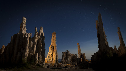 Mono Lake Tufa formations in moonlight. Shallow depth of field with focus on the light painted rock formation.