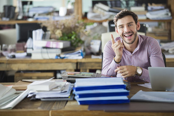 Cheerful male architect in the office
