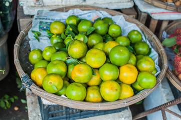 Limes in the wicker basket on the Vietnamese market