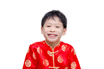 Chinese boy in traditional costume smiling over white