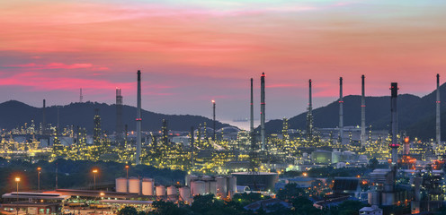 Oil refinery plant at sunset