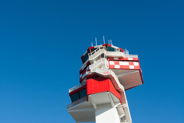Airport, air traffic control tower in white and red. Rome, Italy