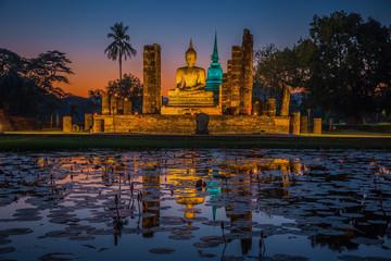 Buddha Statue at Wat Mahathat in Sukhothai Historical Park Wall mural
