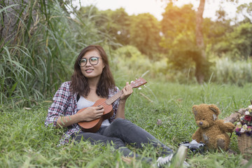 Beautiful girls living ukulele in a beautiful natural radiance w