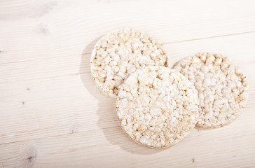 White rice waffles on wooden background