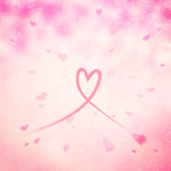 Artistic blurry heart symbol on abstract motion blurred pink colored background.