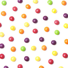 Food pattern. Colorful candies on white background
