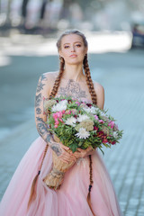 Wedding flowers bride ,Woman holding colorful bouquet with her hands. Tattoo