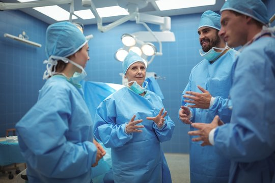 Team of surgeons having discussion in operation theater