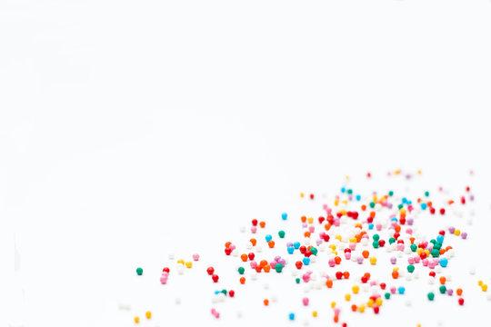 sprinkles on a white background. Festive background for Valentin