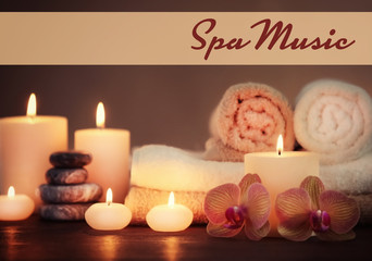 Spa music concept. Candles with flowers on table