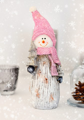 Snowman with christmas tree. Christmas toy. Christmas festive background with snow