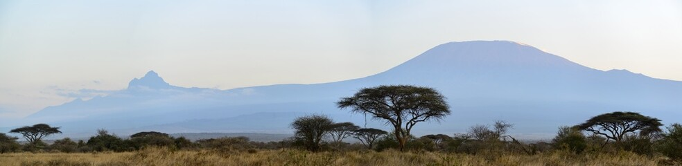 Mount (Mt) Kilimanjaro and Mount (Mt)  Mawenzi (both in in Tanzania) on the left from Satao Elerai Conservancy. Near Amboseli National Park. Kenya.