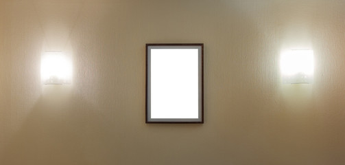 thin portrait photo frame on wall with two lamps
