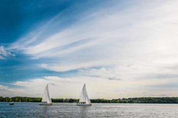 Yachts on the background of blue sky. Sailing yacht race.Match race, picture with space for text or logos
