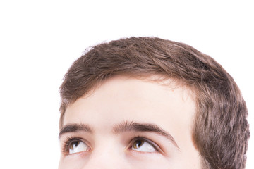 Close up portrait of a boy looking up, isolated on white backgro