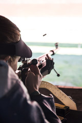Bullet in the air after woman shooting her sporting rifle in a shooting range