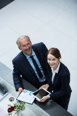 Businessman standing with colleague