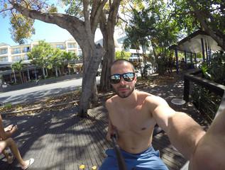 Man taking a selfie in Airlie Beach, Queensland, Australia