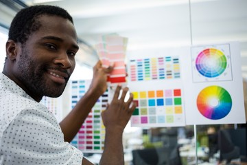 Graphic designer holding color swatch