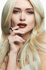 young blonde beautiful woman with make-up.Sexy Blond girl in jewelry,hairstyle