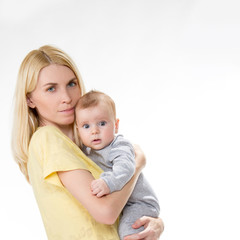 blond caucasian mother holding cute baby