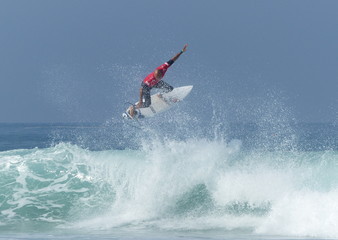 Kelly Slater spinning on an Air during the 2014 Quik Pro France