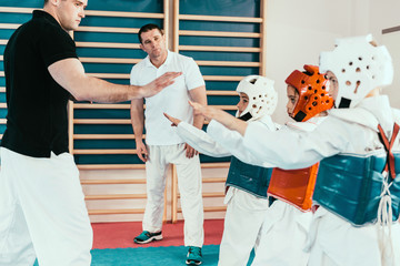 Tae kwon do instructors on class with children