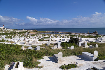 View from the coastal town of Mahdia in Mahdia Governorate of Tunisia, eastern Mediterranean coast with ruins of Fatimid Caliphate and graveyard.