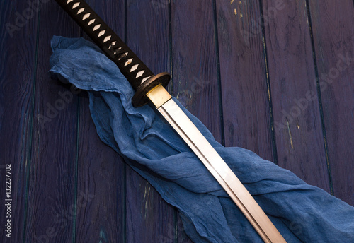 japan katana sword on the wood background with the blue. Black Bedroom Furniture Sets. Home Design Ideas