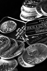 Silver Coins and Bars Representing Wealth