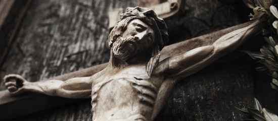 a wooden sculpture of crucified Jesus Christ  (styled retro)