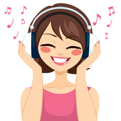 Beautiful young brunette woman listening music with earphones