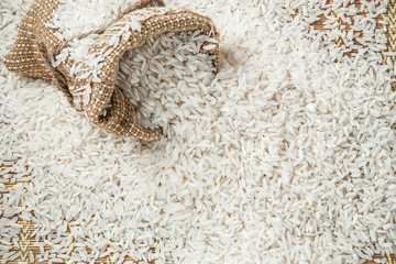 Rice in the burlap bag on the rice background. Healthy eating and lifestyle.